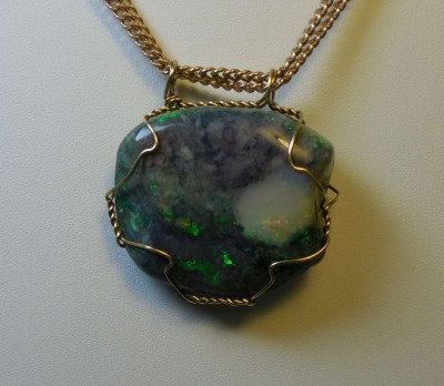 Opal wrapped in brass back side