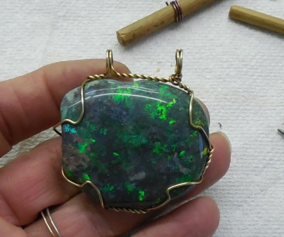 Opal wrapped in brass