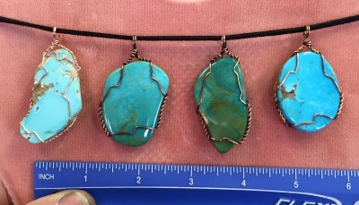 Turquoise free-form cab with some natural surface wrapped in copper wire - 4