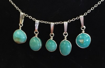 5 pendants of amazonite set in SS wire.